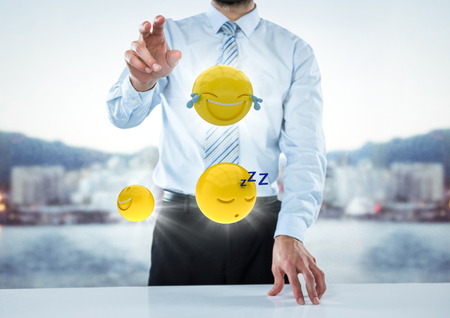 touch sensitive: Digital composite of Business man at desk with emojis and flares against blurry skyline