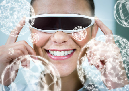 invisible: Digital composite of Woman wearing VR Virtual Reality Headset with Interface Stock Photo
