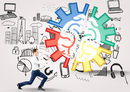 Digital composite of Brain in a cog and business man pushing it Stock Photo