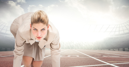 top animated: Digital composite of Business woman at start line on track against flares