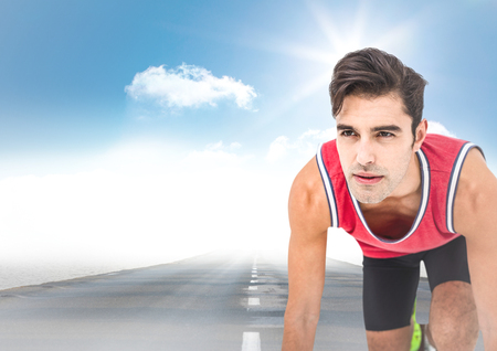 Digital composite of Male runner on road and sky with sun Stock Photo