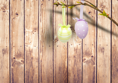 bleached: Digital composite of Easter eggs hanging in the garden. Stock Photo