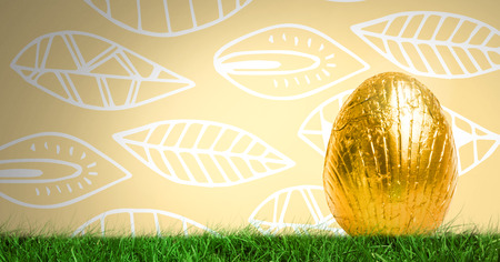 Digital composite of Easter Egg in front of leaf pattern Stock Photo