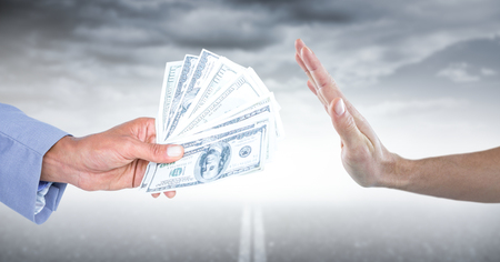 Digital composite of Hand refusing money against road and stormy sky