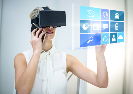 Digital composite of Woman wearing VR Virtual Reality Headset with Interface with phone