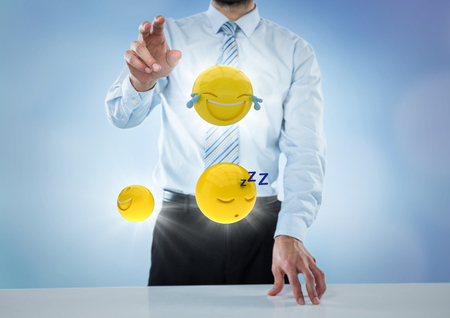 touch sensitive: Digital composite of Business man at desk with emojis and flares against blue background