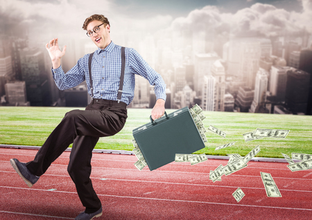 Digital composite of Business man on track with money falling out of briefcase against skyline with clouds