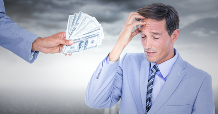 Digital composite of Business man refusing money against stormy sky Stock Photo