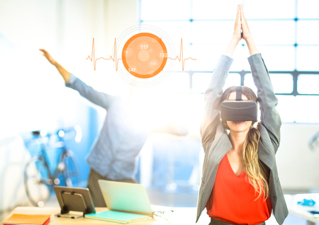 Digital composite of Woman doing yoga exercise wearing VR Virtual Reality Headset with Interface