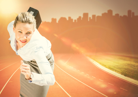 Digital composite of Business woman running with briefcase against orange flare and skyline