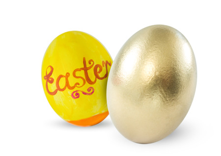 Digital composite of Easter egg and gold egg in white background.