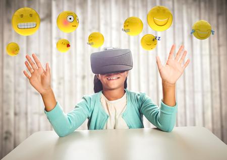high def: Digital composite of Kid in VR beneath emojis against blurry wood panel Stock Photo