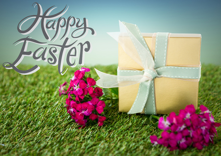 Digital composite of Grey and white type next to gift and pink flowers on grass against blue green background