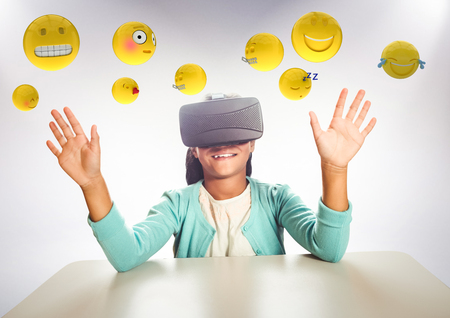 Digital composite of Kid in VR beneath emojis against white background Stock Photo