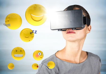 Digital composite of Woman in VR with emojis and flares against blurry grey wood panel