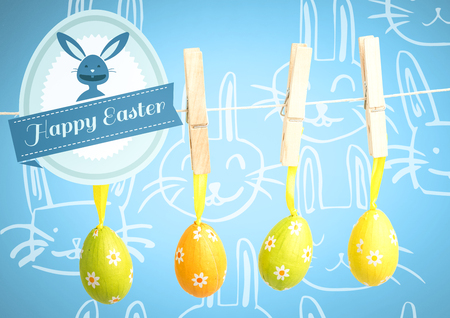 Digital composite of Happy Easter text with Easter Eggs on pegs in front of pattern