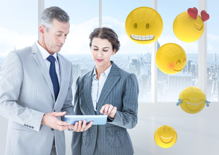 scrolling: Digital composite of Business people with tablet against window and emojis