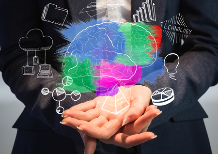lighting background: Digital composite of Color brain with graphic about  business in the hands of a business woman Stock Photo