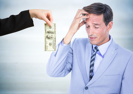 pounding head: Digital composite of Business man refusing money against blurry grey wood panel Stock Photo