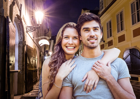 tablet pc in hand: Digital composite of Couple at night in the city Stock Photo