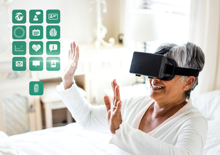 Digital composite of Older Woman wearing VR Virtual Reality Headset with Health Medical Interface