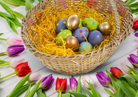leds: Digital composite of Happy Easter table with flowers and basket with Easter eggs