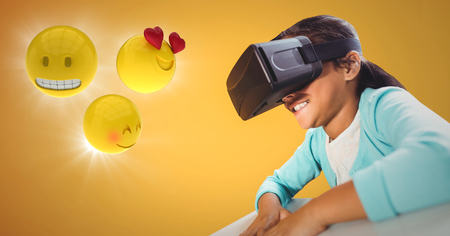 Digital composite of Girl in VR with emojis and flares against yellow background