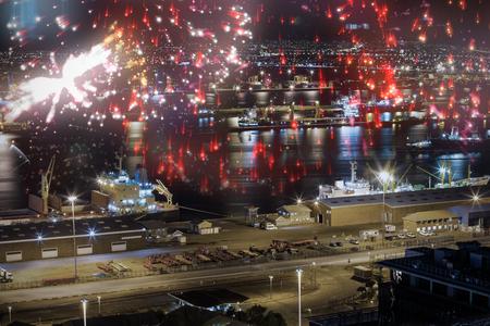 Colourful fireworks exploding on black background against illuminated harbor against cityscape