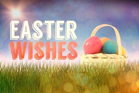 Easter eggs in wicker basket against glowing background
