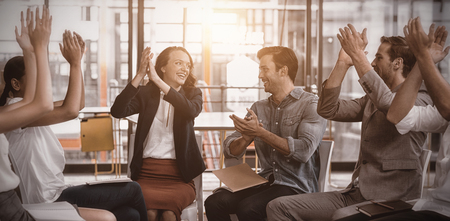 Business executives applauding after presentation in office Stock Photo