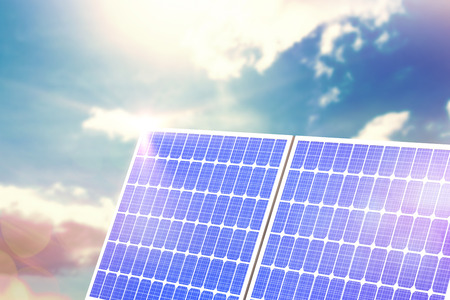 beaming: Digital composite of 3d solar panel against graphic background