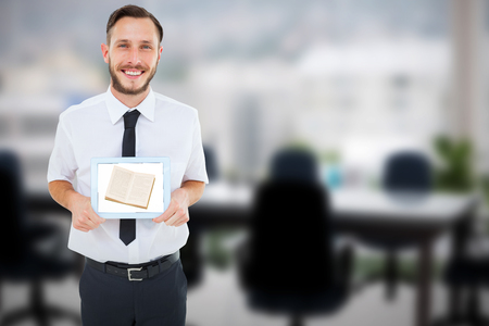 geeky: Geeky businessman showing his tablet pc against computer graphic image of empty board room