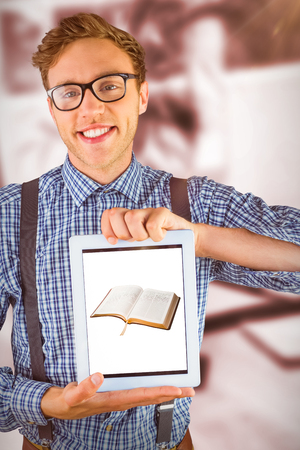 Geeky businessman showing his tablet pc against high angle view of open book