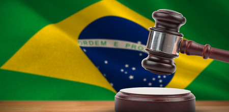 Hammer and gavel against 3d generated brazil national flag Stock Photo