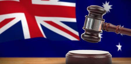 Hammer and gavel against 3d digitally generated australian national flag