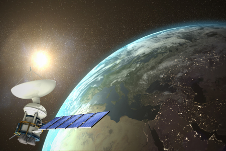 Low angle view of 3d solar powered satellite against aerial view of the earth