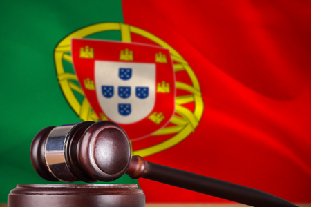 law of portugal: Hammer and gavel against 3d digitally generated portugese national flag
