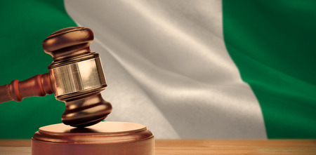 Hammer and gavel against 3d digitally generated nigerian national flag Stock Photo