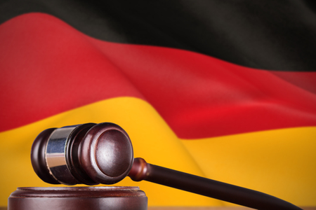 Hammer and gavel against 3d digitally generated german national flag Stock Photo