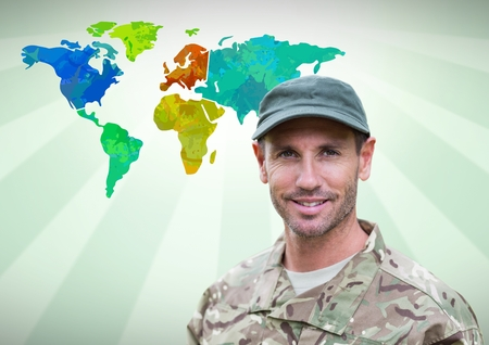 mid adult men: Digital composite of Army soldier man in front of Colourful Map