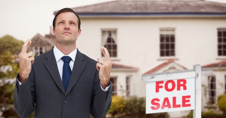 Digital composite of Business man with his fingers crossed, property sale