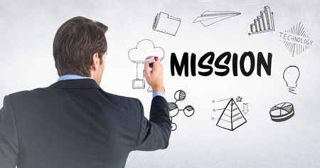 reach out: Digital composite of Back of business man with marker against mission doodles and white wall