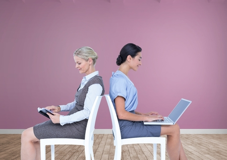 Digital composite of Businesswomen collaborating working back to back on chairs