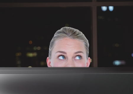 envelope: Digital composite of Business woman working in the office at night
