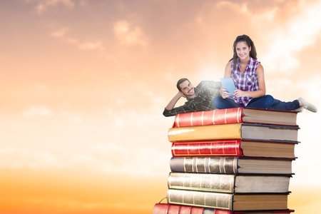 Digital composite of Composite image of couple on books