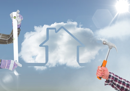Digital composite of hands with tools in the sky with house cloud. Stock Photo