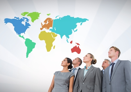 Digital composite of Business people looking at Colorful Map with wall background