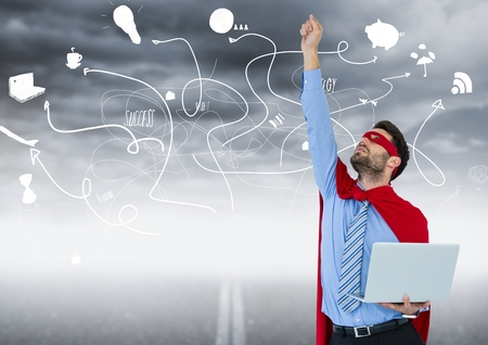 Digital composite of Business man superhero with laptop and hand in air against road and stormy sky with business doodles Stock Photo
