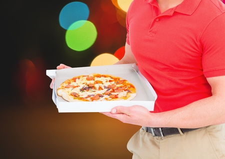 illuminated: Digital composite of Deliveryman with pizza. Lights background