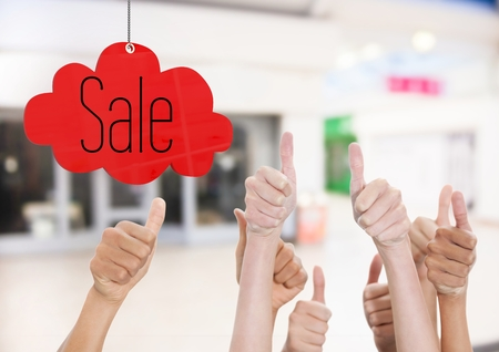Digital composite of Thumbs up in the shopping center, sale Stock Photo